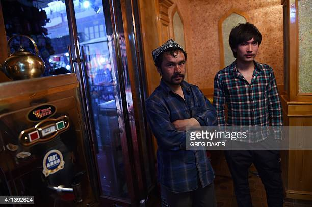 This photo taken on April 15 2015 shows two Uighur men in a restaurant in Hotan in China's western Xinjiang region AFP PHOTO / Greg BAKER