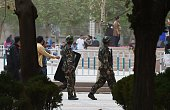 This photo taken on April 16 2015 shows paramilitary police patrolling beside the central square in Hotan in China's western Xinjiang region Xinjiang...