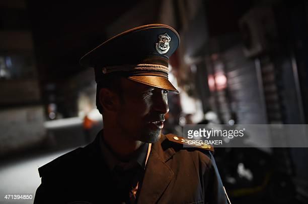 This photo taken on April 17 2015 shows a Uighur security guard in a Uighur neighborhood in Aksu in China's western Xinjiang region AFP PHOTO / Greg...