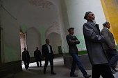 This photo taken on April 19 2015 shows Uighur men walking into the Id Kah mosque for afternoon prayers in Kashgar in China's western Xinjiang region...
