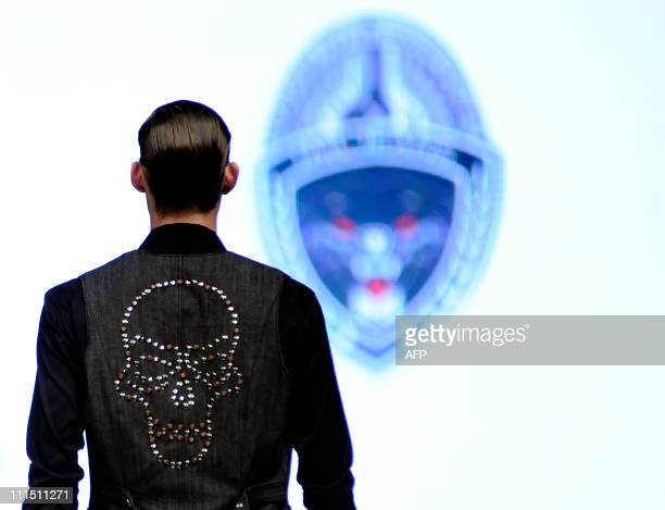 This photo taken on April 2 2011 shows a model presenting a creation from Jail Jeans by Philippines designer Chris Jasler on day four of the men's...