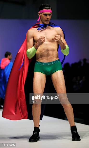 This photo taken on April 2 2011 shows a model showcasing '2ist' underwear on day four of the men's fashion week event at the Sands Expo and...