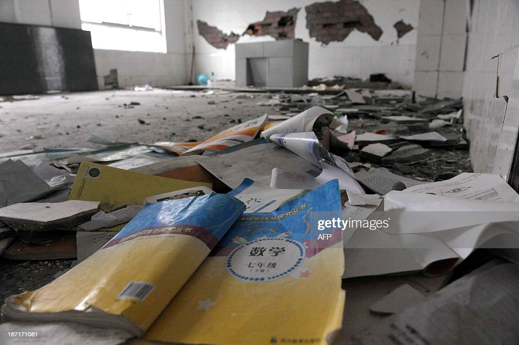 This photo taken on April 21, 2013 shows textbooks lying on the ground in a damaged classroom in disaster-hit Ya'an, southwest China's Sichuan province. Clogged roads, debris and landslides impeded rescuers as they battled to find survivors of a powerful earthquake in mountainous southwest China that has left at least 188 dead. CHINA