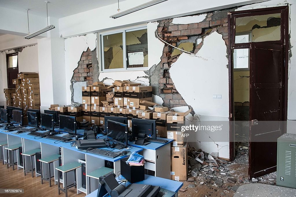 This photo taken on April 22, 2013 shows a damaged computer room in Lingguan Middle School in Baoxing county of Yaan, southwest China's Sichuan province. Clogged roads, debris and landslides impeded rescuers on April 22 as they battled to find survivors of a powerful earthquake in mountainous southwest China that has left at least 192 dead. CHINA