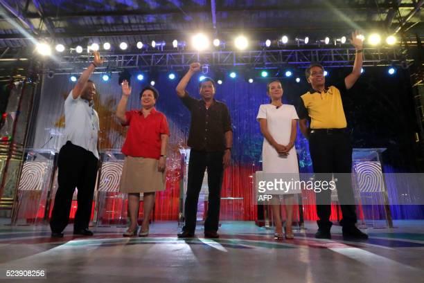 This photo taken on April 24 2016 shows Philippine presidential candidates VicePresident Jejomar Binay Senator Miriam Santiago Davao City Mayor...