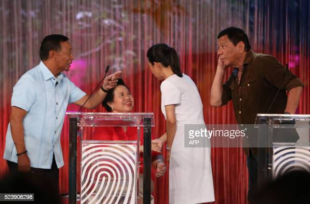 This photo taken on April 24 2016 shows Philippine presidential candidates VicePresident Jejomar Binay gesturing to Davao City Mayor Rodrigo Duterte...
