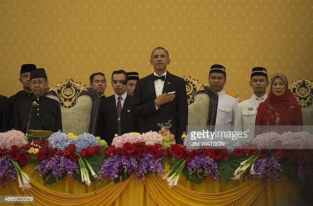 This photo taken on April 26 2014 shows US President Barack Obama standing with Malaysain Sultan Abdul Halim of Kedah and Queen Haminah during a...