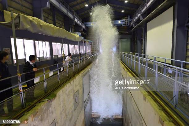 This photo taken on April 6 2017 shows a reproduction of a tsunami in a huge wave pool at the Port and Airport Research Institute in Yokosuka...