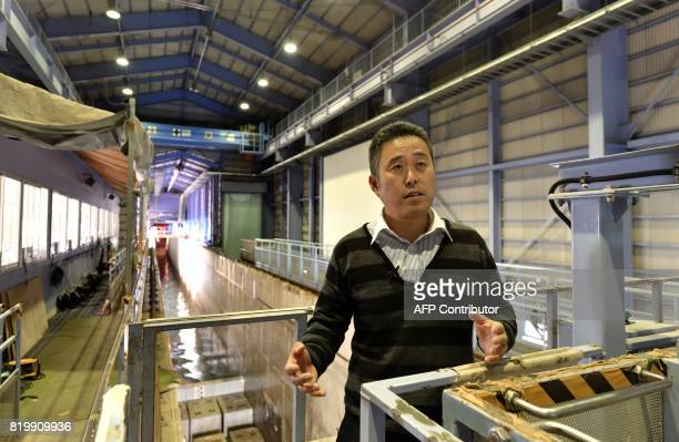 This photo taken on April 6 2017 shows Kojiro Suzuki a tsunami researcher at the Port and Airport Research Institute speaking during an interview at...