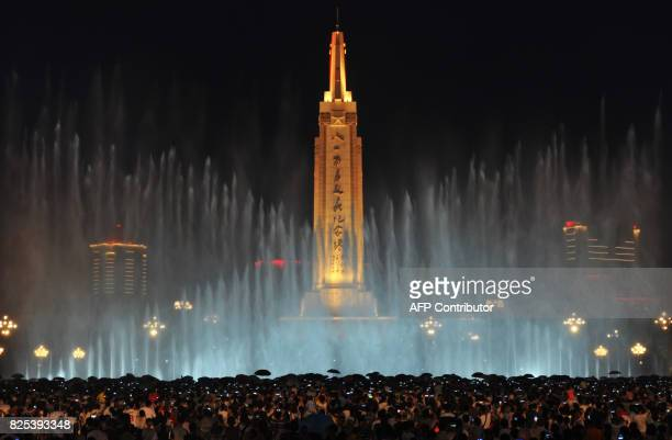 This photo taken on August 1 2017 shows people gathering by the fountain on Bayi Square to celebrate the 90th anniversary of the People's Liberation...