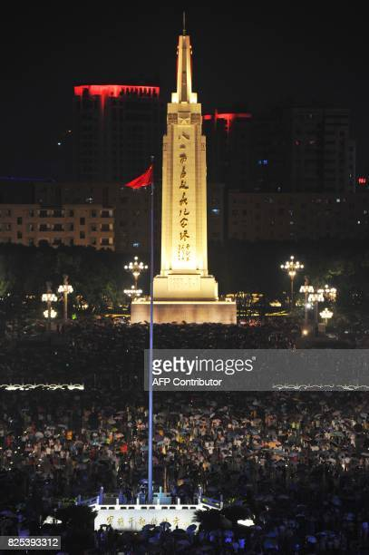 This photo taken on August 1 2017 shows people gathering on Bayi Square to celebrate the 90th anniversary of the People's Liberation Army in Nanchang...