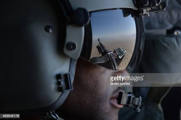 This photo taken on august 11 2014 shows a US soldier part of the NATOled International Security Assistance Force manning a machine gun onboard a...