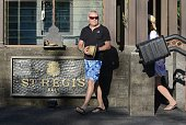 This photo taken on August 12 2014 shows foreign tourists walking past the St Regis hotel in Nusa Dua on the Indonesian resort island of Bali A US...