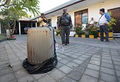 This photo taken on August 12 2014 shows the suitcase where the body of a woman was found inside displayed at a police station in Nusa Dua on the...