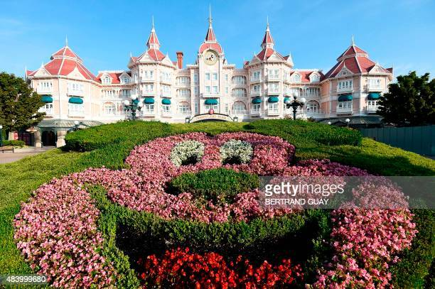 This photo taken on August 13 2015 shows a floral arrangement in the shape of Mickey Mouse in front of the Disneyland Hotel at The Walt Disney...
