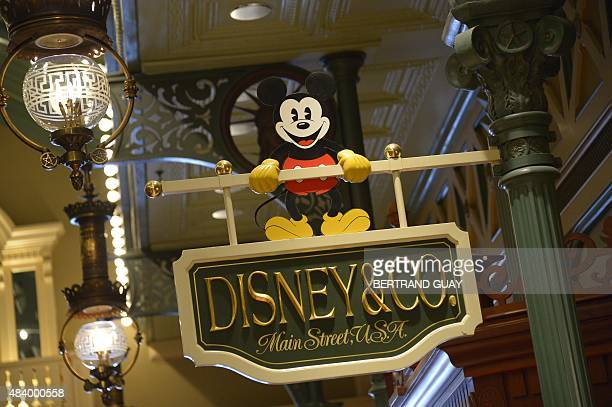 This photo taken on August 13 2015 shows a sign for Main Street USA at Disneyland Paris in MarnelaVallee AFP PHOTO / BERTRAND GUAY