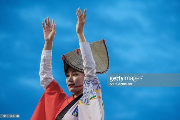 TOPSHOT This photo taken on August 13 2017 shows a dancer performing during the Awa Odori festival in Tokushima The fourday dance festival attracts...