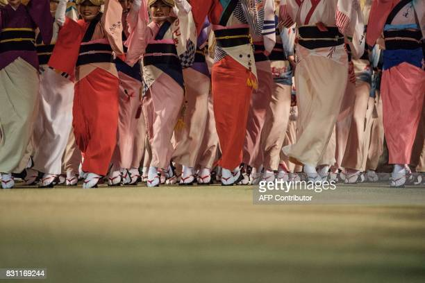 This photo taken on August 13 2017 shows dancers performing on a stage during the Awa Odori festival in Tokushima The fourday dance festival attracts...