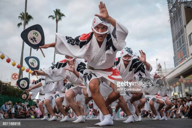 TOPSHOT This photo taken on August 13 2017 shows Eiji Ohmatsudani of the Sasaren leading dancers on a street during the Awa Odori festival in...