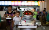This photo taken on August 13 shows a robot carrying food to customers in a restaurant in Kunshan It's more teatime than Terminator a restaurant in...