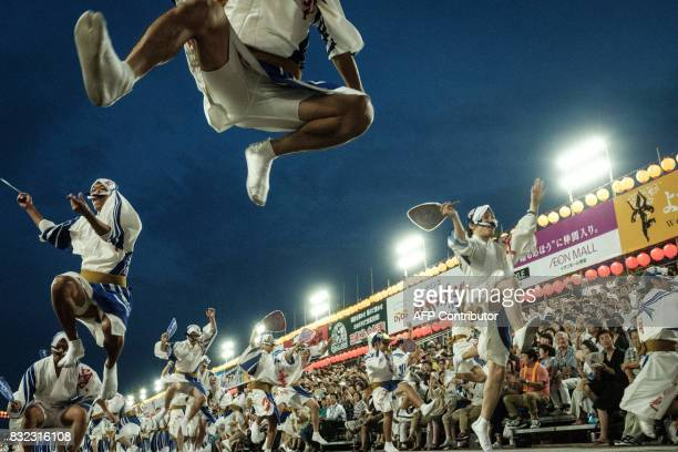 TOPSHOT This photo taken on August 14 2017 shows dancers from Hazukiren performing during the Awa Odori festival in Tokushima The fourday dance...