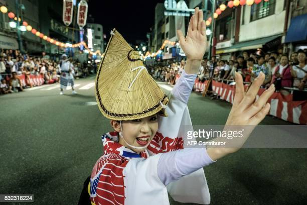 This photo taken on August 15 2017 shows a dancer of Ahouren performing on street during the Awa Odori festival in Tokushima The fourday dance...