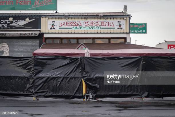This photo taken on August 15 2017 shows a makeshift memorial in front of the scene of a car crash into a pizza restaurant in SeptSorts 55km east of...
