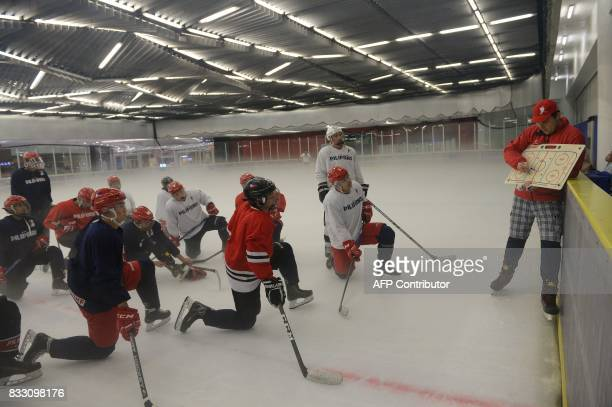 TOPSHOT This photo taken on August 15 2017 shows head coach Daniel Brodan giving instructions to members of the Philippines men's ice hockey team...