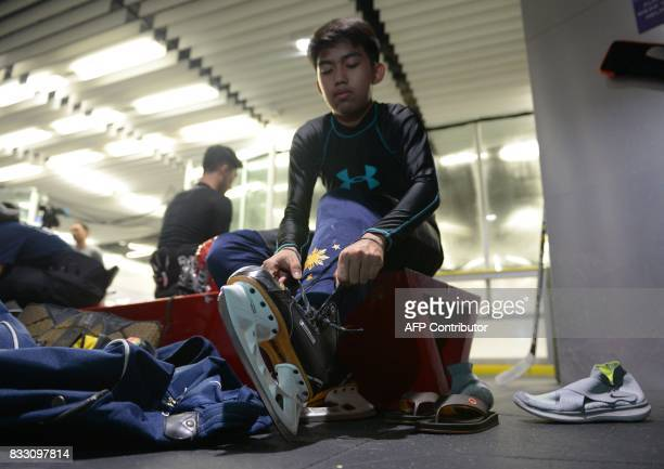 This photo taken on August 15 2017 shows members of the Philippines men's ice hockey team dubbed the 'Mighty Ducks' preparing their gear prior to a...