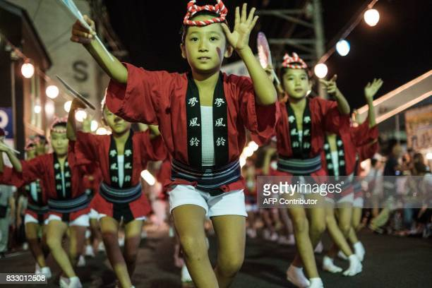 This photo taken on August 16 2017 shows girls performing on a street at the Ikeda Awa Odori Festival in the city of Miyoshi about 80 kms west of...