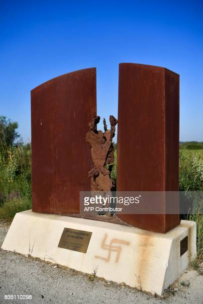 This photo taken on August 18 2017 in Arles southern France shows a swastika spraypainted on the Saliers' memorial built to commemorate the Roma...