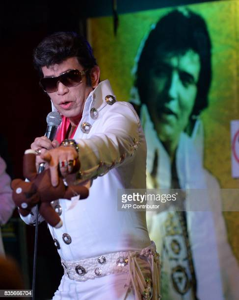 This photo taken on August 19 2017 shows Buddy Reyes an impersonator of US music legend Elvis Presley performing during the first annual Elvis Asia...