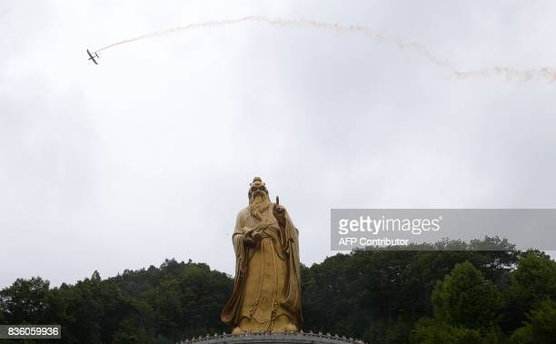 This photo taken on August 20 2017 shows a model plane performing a stunt in the sky during the Laojun Mountain Drone Convention in Luoyang in...