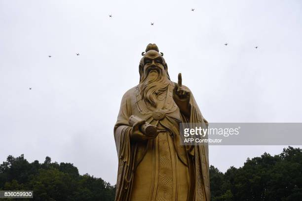 TOPSHOT This photo taken on August 20 2017 shows drones flying above the statue of Lord Laozi during the Laojun Mountain Drone Convention in Luoyang...