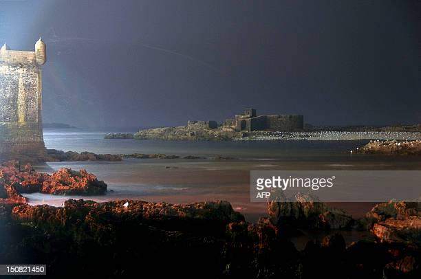 This photo taken on August 24 shows a beach in Essaouira at night AFP PHOTO FADEL SENNA