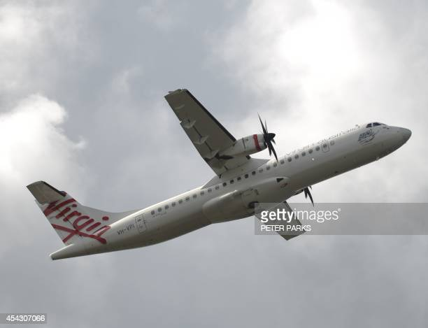 This photo taken on August 28 2014 shows a Virgin Australia plane taking off at Sydney Airport in Sydney Virgin Australia posted an annual net loss...