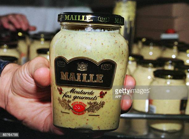 This photo taken on August 3 1999 shows a pot of mustard from the production line at the Unilever Amora factory in Dijon France The group Amora...