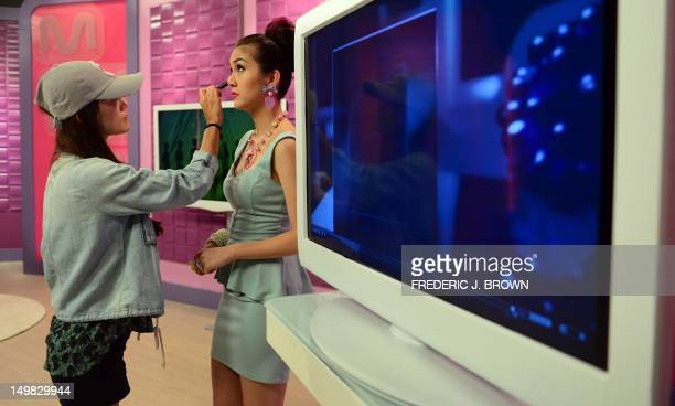 This photo taken on August 3 2012 shows host Chrissa Villanueva receiving makeup before facing the cameras during a taping of an episode of 'Hello...