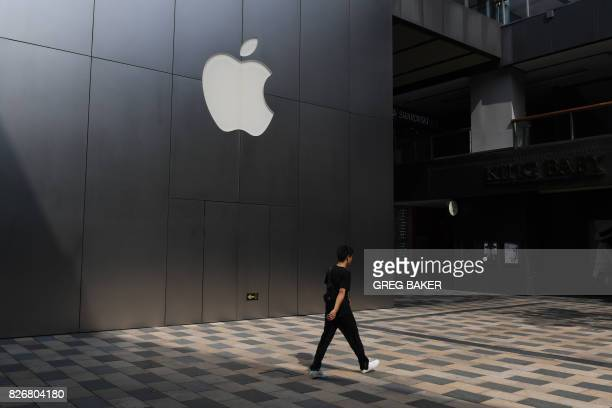 This photo taken on August 3 2017 shows a man walking past an Apple store in Beijing Enterprising internet users in China fear the tools they use to...