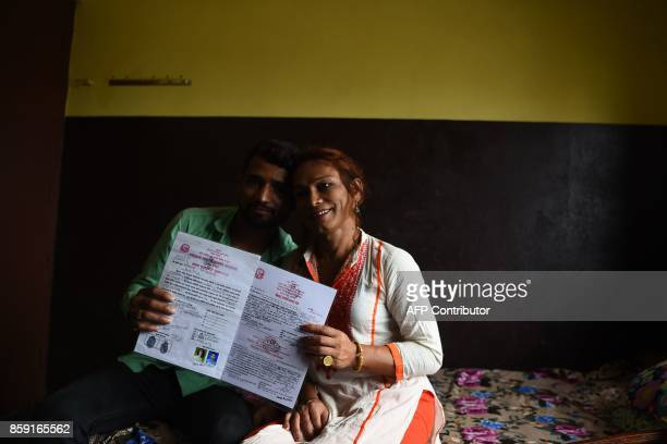 This photo taken on August 3 2017 shows Nepali transgender person Monika Shahi Nath and her husband Ramesh Nath Yogi holding their marriage...