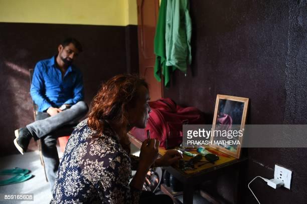This photo taken on August 3 2017 shows Nepali transgender person Monika Shahi Nath looking at a mirror in Kathmandu Monika Shahi Nath became Nepal's...