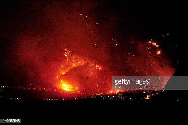 This photo taken on August 6 shows a fire raging in the mountains around San Vito Lo Capo near Trapani in Sicily Fires flared up in Italy's south...