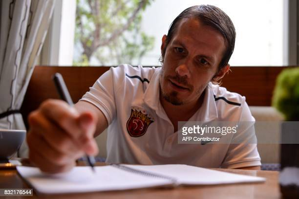 This photo taken on August 7 2017 shows Shanghai SIPG football club director Mads Davidsen making notes during an interview in Shanghai Davidsen does...