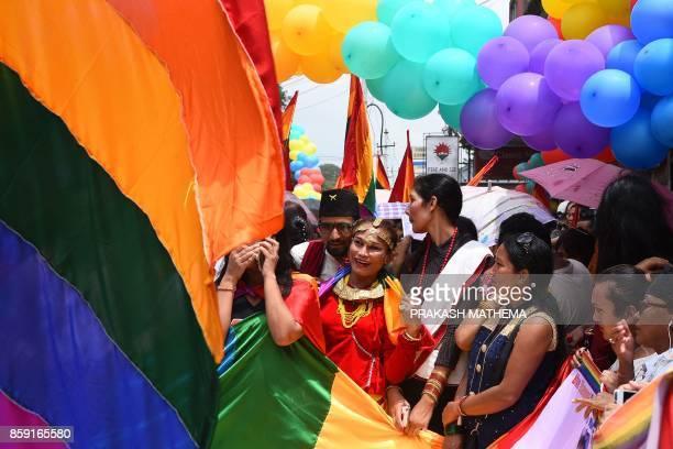 This photo taken on August 8 2017 shows Nepali transgender person Monika Shahi Nath taking part in a gay pride parade in Kathmandu Monika Shahi Nath...