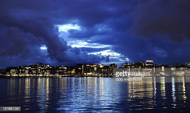 This photo taken on Augut 27 2010 shows the skyline of 'Aker Brygge' the Norwegian capital's waterfront and entertainment area as a break in the...