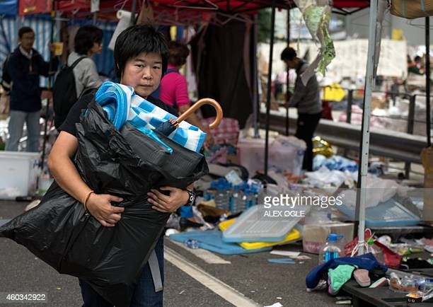 This photo taken on December 11 2014 shows a woman packing up at a prodemocracy protest camp just before police moved in to clear the site next to...