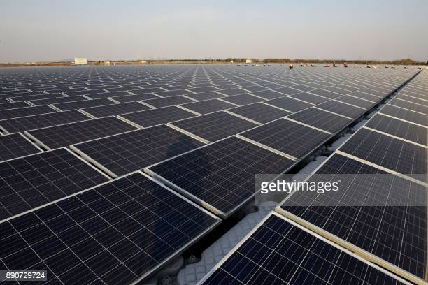 This photo taken on December 11 2017 shows a general view of a floating solar power plant in Huainan a former coalmining region in China's eastern...