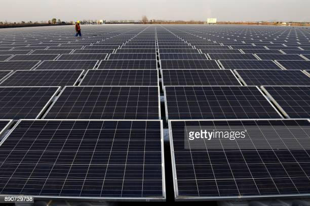 TOPSHOT This photo taken on December 11 2017 shows a general view of a floating solar power plant in Huainan a former coalmining region in China's...