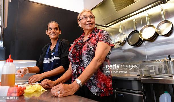 This photo taken on December 12 2012 shows Beryl van Oploo a selfproclaimed 'foodie' from central Australia's Gamilaroi people working with...