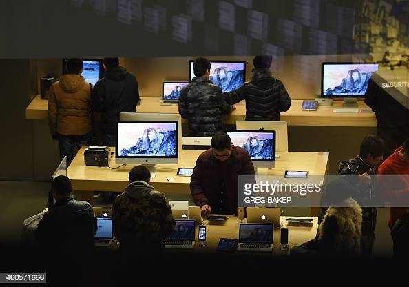This photo taken on December 16 2014 shows customers inside an Apple store in Beijing Retail sales in China increased 117 percent in November...